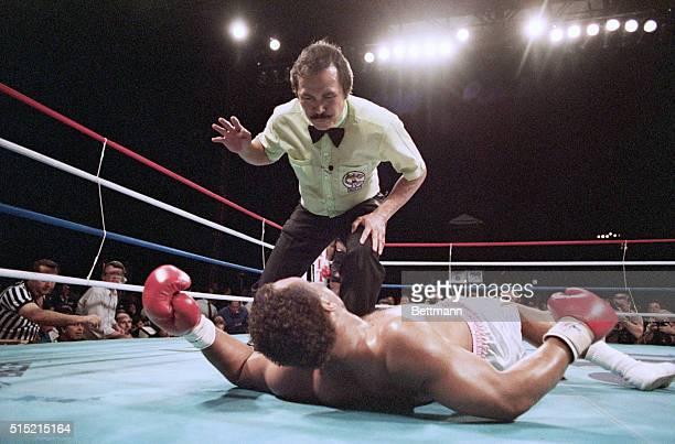 5/30/87Las Vegas NV Referee Carlos Padilla starts his count over Pinklon Thomas in the 6th round but before Padilla finished his count Thomas'...