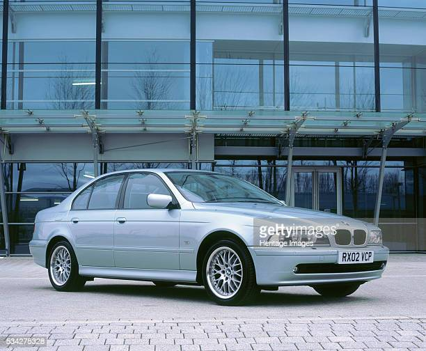 BMW 530i by modern office buildings 2000