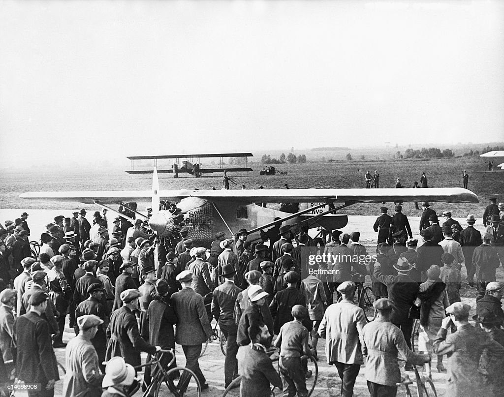 View of the crowds in front of Captain Charles A. lindbergh's plane, 'Spirit of St. Louis' at the Le Bourget Aerodome on the arrival of Lindy in France.