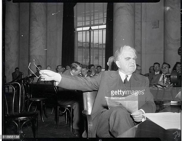 John Llewellyn Lewis , American Labor leader. President of CIO . He is shown seated with a newspaper.