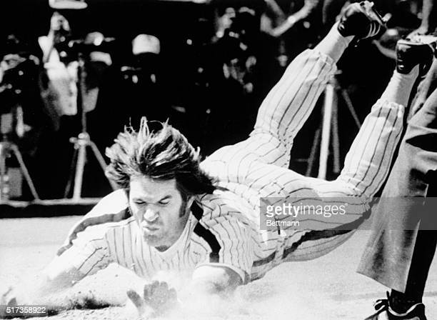 Philadelphia, PA-Phils' Pete Rose slides safely head-first into home plate as he scores on a Manny Trillo triple in the fifth inning of the Phils'...