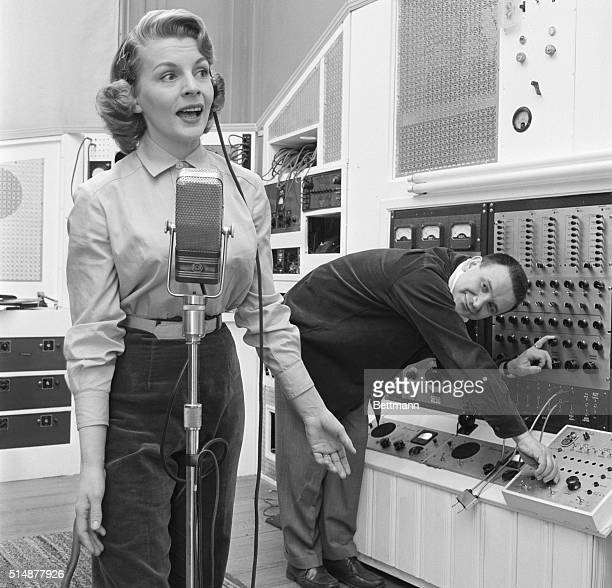 5/3/1957Manhasset New York Composerconductor Raymond Scott and his wife singer Dorothy Collins conduct a recording session in their home studio...