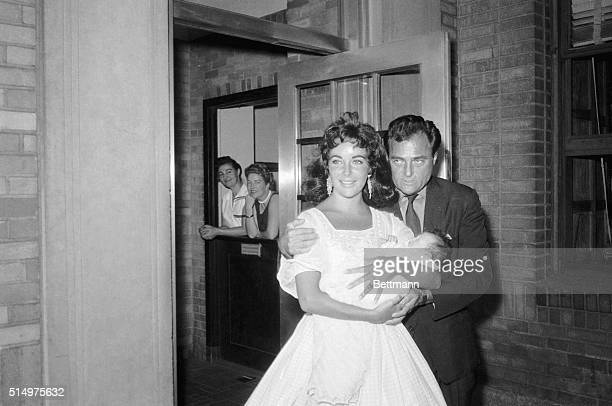5/3/1957New York New York Actress Elizabeth Taylor roducer Mike Todd and their monthold daughter Liza are ogled by sightseers as they leave Harkness...
