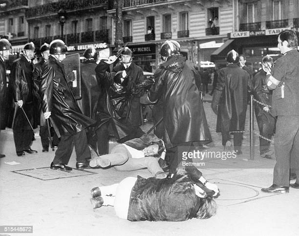 5/3/1968Paris France A student tries to protect his head from policemen's blows as police break up a huge demonstration Feuding student extremists of...