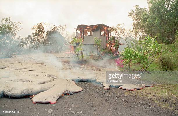 5/3/1990Kalapana Hawaii Fiery lava from the Kilauea volcano consumes a house on it's way to the ocean late 5/2 130 structures have been destroyed