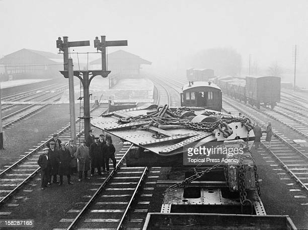 Ton rudder for the Cunard liner Aquitania, carried from Darlington by a special LNER train, joins the main line at Eaglescliffe railway station,...