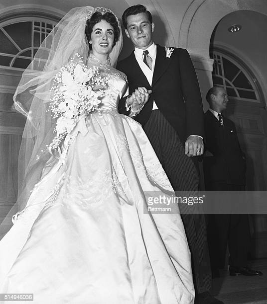 5/6/1950Beverly Hills CA Mr and Mrs Conrad Hilton Jr pause on the steps of the Church of the Good Shepherd here after their wedding The bride is the...