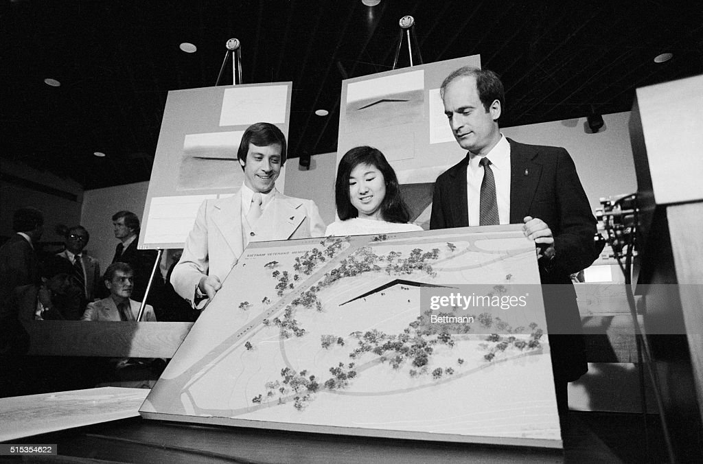 Washington, DC- Jan C. Scruggs (L), President of the Vietnam Veteran's Memorial Fund, and Project Director Bob Doubek (R) display the final design for the memorial, which will be built near the Lincoln Memorial in Washington. With them is Maya Ying Lin, the Yale architecture student who submitted the winning design.