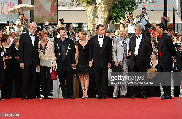 56th International Cannes Film Festival Stairs of La petite Lili in Cannes France on May 22 2003 JeanPierre Marielle with his wife Robinson Stevenin...