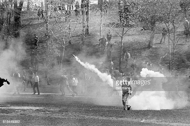 5/7/1970Kent OH Kent State University student hurls tear gas cannister back towards National Guardsmen as the military is called out May 4th to put...
