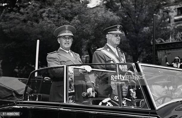 General Francisco Franco Spanish Chief of State accompanied by the army minister General Antonio Barroso reviews the troops from an open car during a...