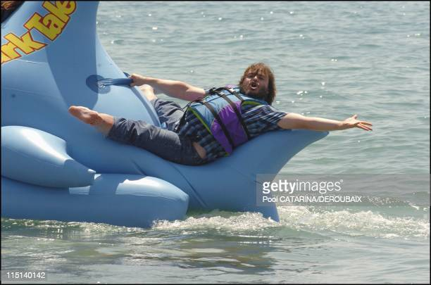 57th Cannes Film Festival Photocall of Shark Tale in Cannes France on May 14 2004 Jack Black voice for the animated film Shark tale riding an...