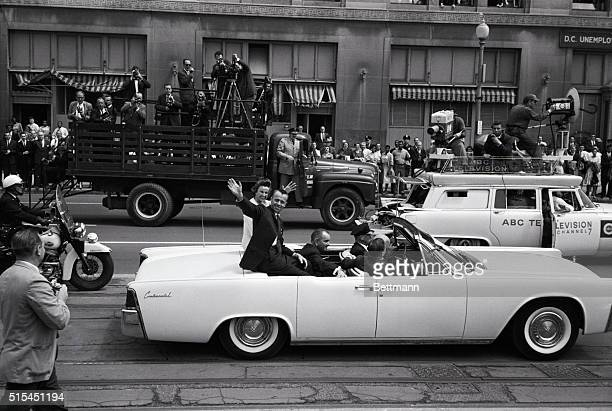 5/8/1961Washington DC Astronaut Alan B Shepard Jr and his pretty wife Louise wave to crowds during a parade from the White House to the US Capitol...