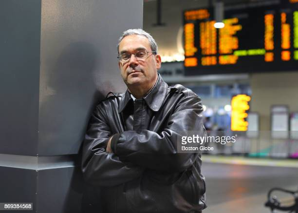 58yearold Acton resident and longtime MBTA commuter rail passenger Jim Yarin poses for a portrait at North Station in Boston where he was arrested on...