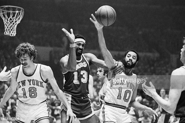 5/9/1973New York NY Wilt Chamberlain of the Los Angeles Lakers grabs Walt Frazier of the New York Knicks around the shoulder and appears to be ready...