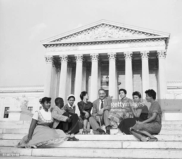 Six black children who attended Little Rock's Central High School earlier in 1958 and two NAACP officials sit outside the Supreme Court in this...