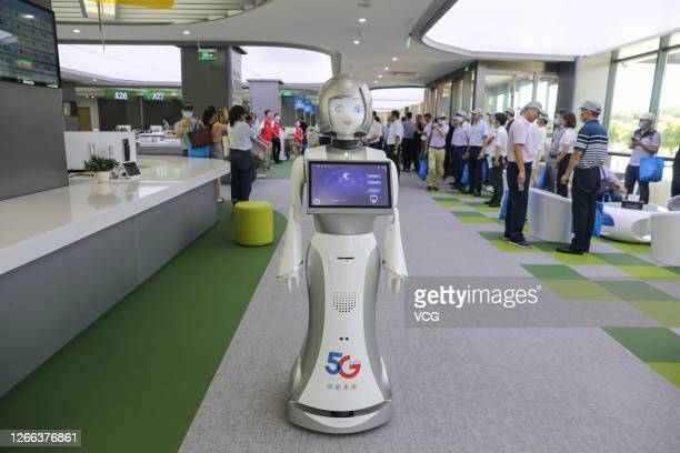 Supported intelligent robot works at the administration service centre on August 14, 2020 in Zhoushan, Zhejiang Province of China.