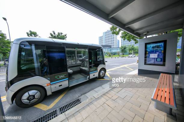 Supported Yutong L4 autonomous driving bus drives along the street on August 11, 2020 in Zhengzhou, Henan Province of China.