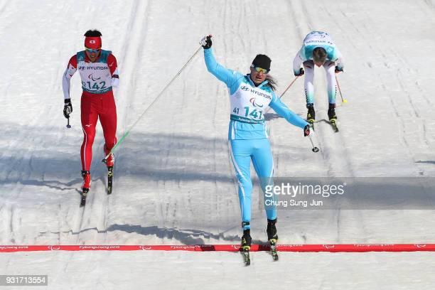 Alexandr Kolyadin of Kazakhstan celebrates after winning the CrossCountry Skiing Men 15km Sprint Classic Final Standing on day five of the...