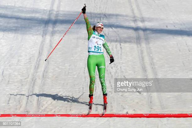Sviatlana Sakhanenka of Belarus celebrates after winning the CrossCountry Skiing W 15km Sprint Classic Final Visually Impaired on day five of the...