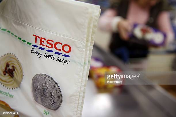 A 5p plastic carrier bag hangs on the end of a checkout at the Tesco Basildon Pitsea Extra supermarket operated by Tesco Plc in Basildon UK on...