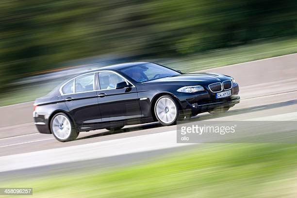 bmw 5-series, high speed - bmw stock pictures, royalty-free photos & images