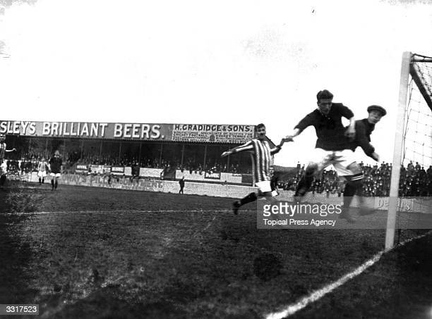 Arsenal forwards give the Manchester United goalkeeper a hard time during their match at Plumstead Arsenal won 21