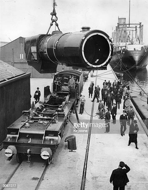 The boiler of the locomotive the 'Royal Scot' being hoisted on to a ship SS Beaverdale at Tilbury Docks for transport to America where it will be on...