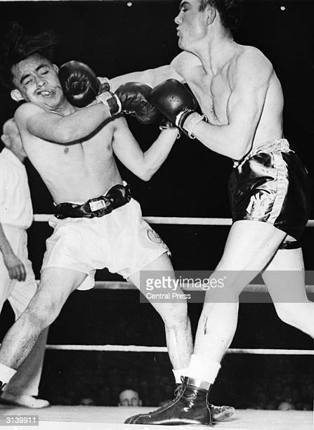 American marine Laverne Roach lands a swinging right hand on the head of Gilbert Garcia during the InterCity Golden Gloves Championships
