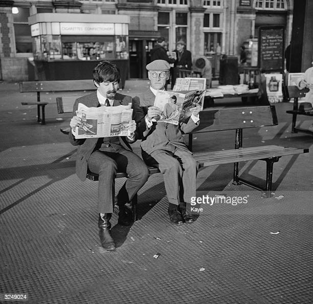 Beatle Paul McCartney at Marylebone London with Wilfrid Brambell playing Paul's grandfather during filming of the Beatles' film 'A Hard Day's Night'...