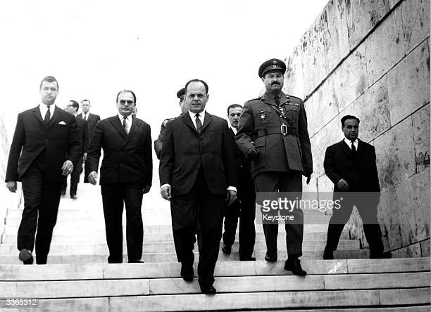 Greek Prime Minister Georgios Papadopoulos leaving the tomb of the unknown soldier in Athens having laid a commemorative wreath on the anniversary of...