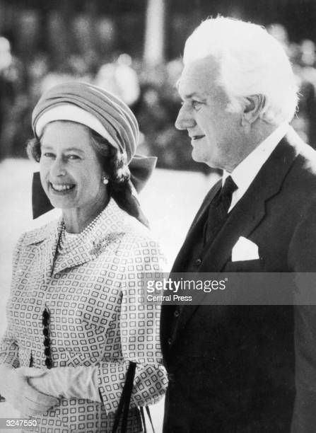 Sir John Kerr the GovernorGeneral of Australia escorts Queen Elizabeth II to her aircraft at Perth Airport following her Jubilee Tour of the country