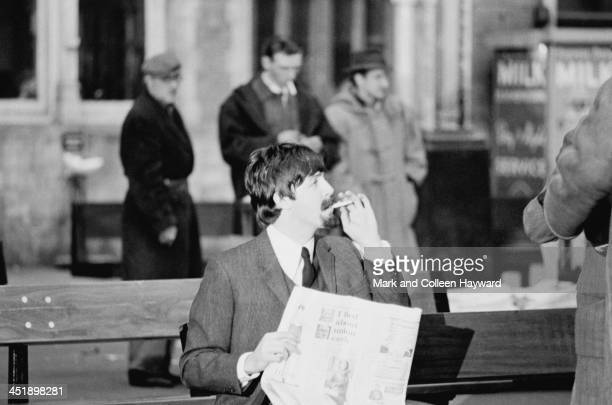 Paul McCartney from The Beatles wears a false beard and moustache during the filming of 'A Hard Day's Night' at Marylebone Station in London on 5th...