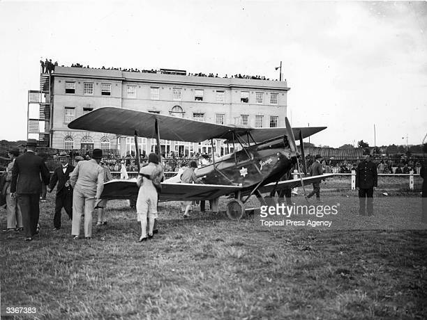 English aviator Amy Johnson arrive back in Britain with her 'Jason' plane after her pioneering solo flight to Australia