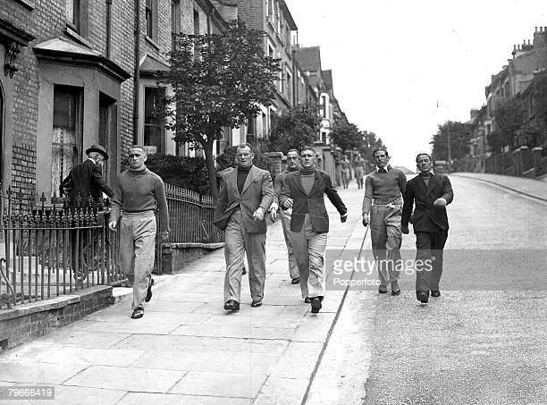 5th August 1936 Arsenal footballers back in training for the imminent start to the new season are taken for long walks around the streets of Londons...