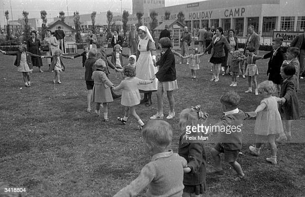 Children playing in their own compound at the Butlin's holiday camp in Skegness Original Publication Picture Post 193 Holiday Camp pub1939