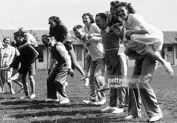 Competitors in a Butlin's holiday camp piggyback race getting ready at the starting line Original Publication Picture Post 193 Holiday Camp pub 1939