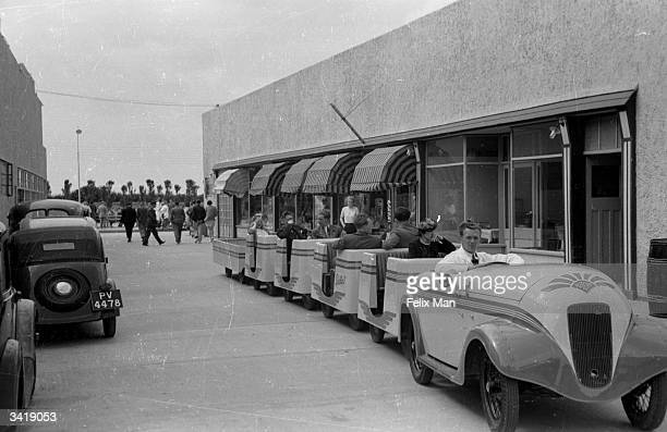 Holidaymakers riding the 'train' at Butlin's Holiday Camp Skegness Lincolnshire Original Publication Picture Post 193 Holiday Camp pub 1939
