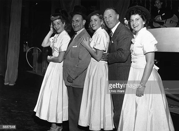British comedy duo Flanagan and Allen with the American singers the Andrews Sisters