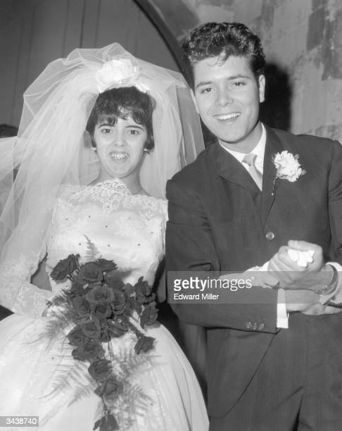 Pop singer Cliff Richard gives away his sister 18yearold Donella Webb during her wedding to Paul Stevens at Waltham Abbey A few moments before...