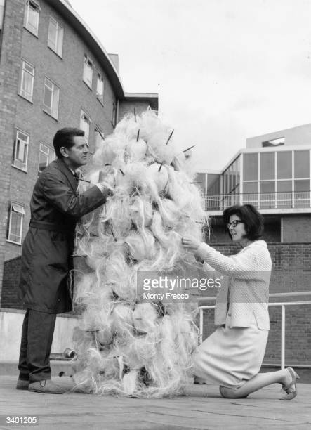 Daphne Dare who designs all the Dr Who costumes with her latest creation a Varga Assisting is John Athins of the BBC wardrobe Dept