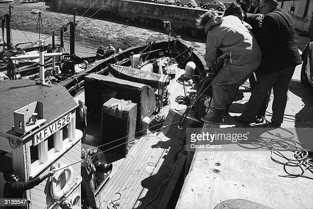 Coffins are unloaded from a boat at Falmouth Cornwall after nineteen passengers died in the 'Darlwin' pleasure boat disaster