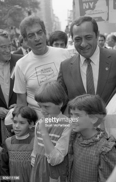 New York Governor Mario Cuomo poses for pictures with a group of children on the streets of New York City Governor Cuomo is pushing the Bond Issue...