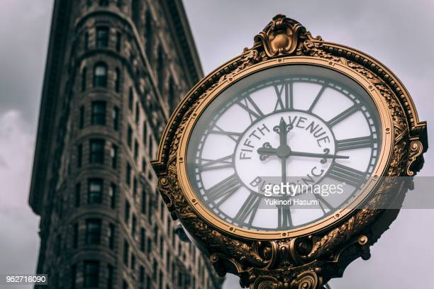 5th avenue building clock, madison square - international landmark stock pictures, royalty-free photos & images