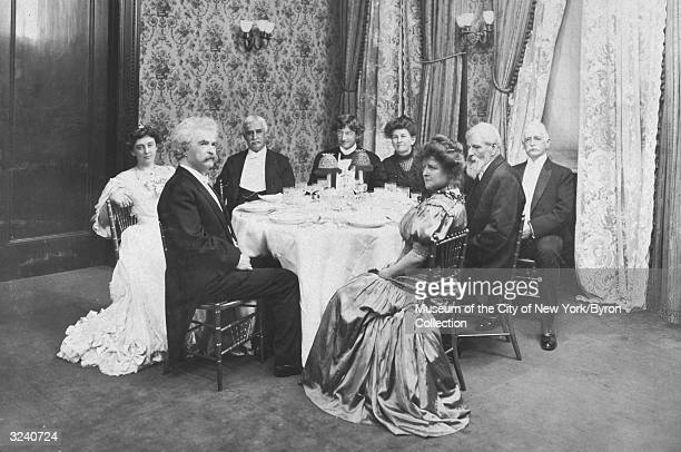American writer Mark Twain and his party sitting around a dining table at Delmonico's Restaurant to celebrate his 70th birthday northeast corner of...