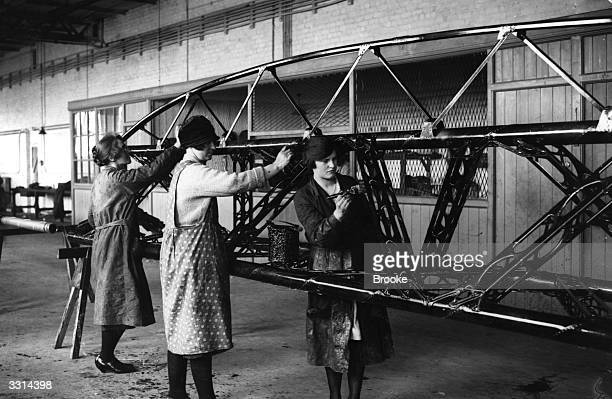 Three women varnishing the duralumin girders for the Airship R100 at Howden