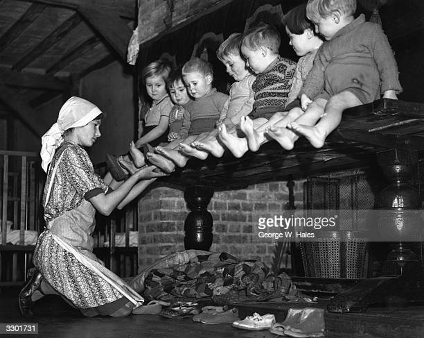 A row of toddlers evacuated from London during the Blitz have their feet inspected at their new home in a 15th century mansion house in Kent