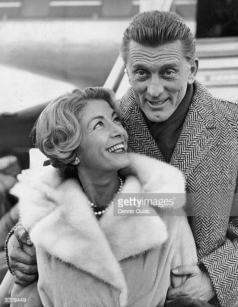 Kirk Douglas and his wife Anne Budyens arriving in London for the premiere of his new film, 'Spartacus'.