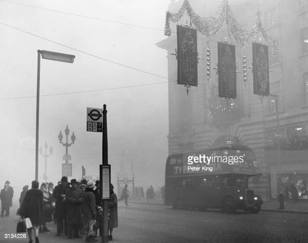 A heavy fog descends on Christmas shoppers in London's Regent Street