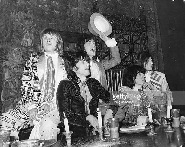 British rock group the Rolling Stones in the Elizabethan Room at Gore Hotel Kensington where they held a beggars banquet complete with serving...